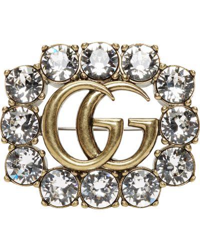 Złota broszka Gucci