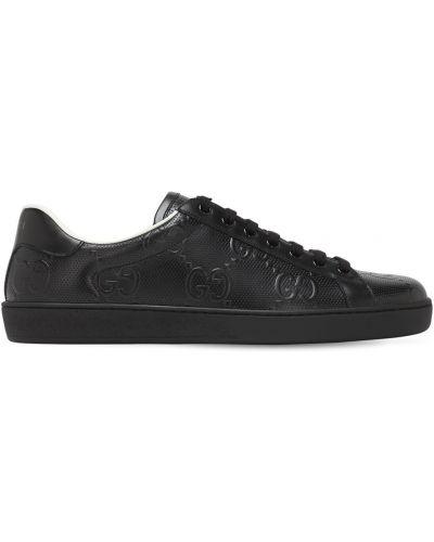 Черные кожаные кроссовки с тиснением Gucci