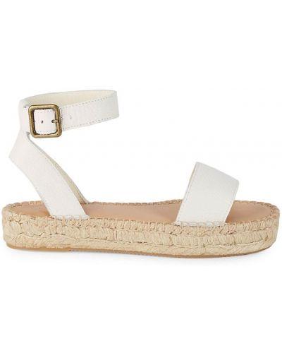 Białe sandały z klamrą Soludos