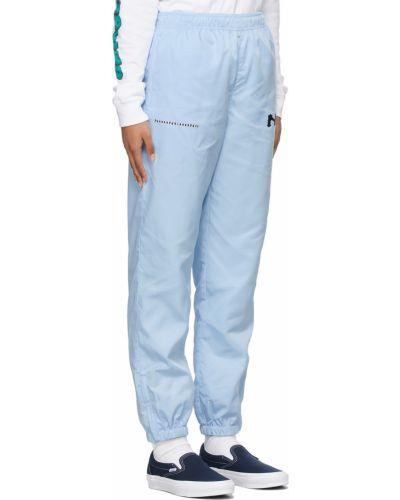 Białe satynowe spodnie Noon Goons