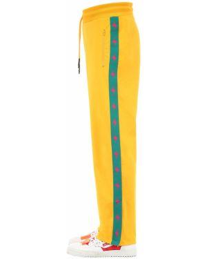 Żółte spodnie z haftem Guess X J Balvin Vibras Collection