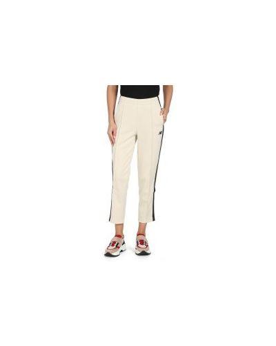 Бежевые брюки New Balance