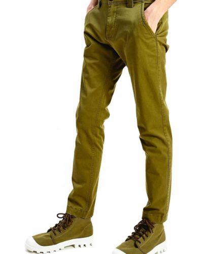 Zielone spodnie w paski Tommy Jeans