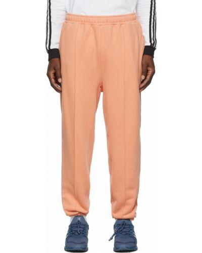 Pomarańczowe spodnie w paski Adidas X Ivy Park