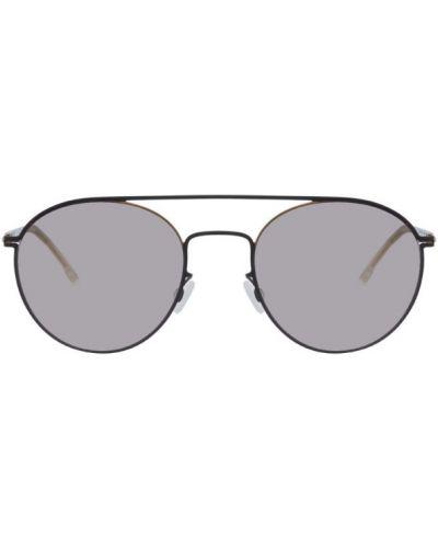 Облегченные черные солнцезащитные очки круглые с тиснением Mykita