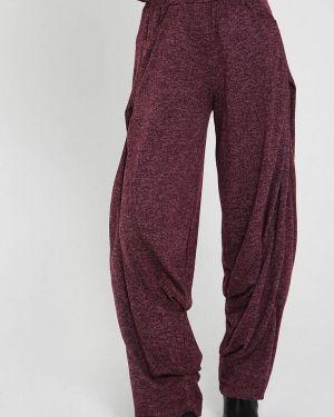 Свободные брюки расклешенные фиолетовые мадам т