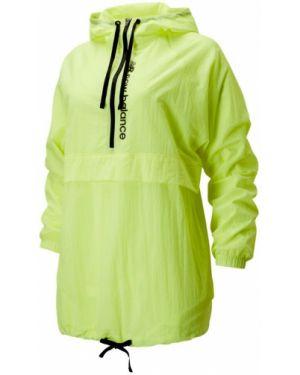 Спортивная желтая спортивная куртка New Balance