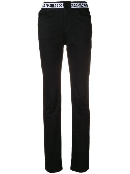 Хлопковые черные джинсы эластичные на пуговицах Versus