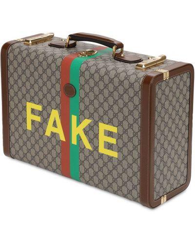 Beżowa walizka skórzana Gucci