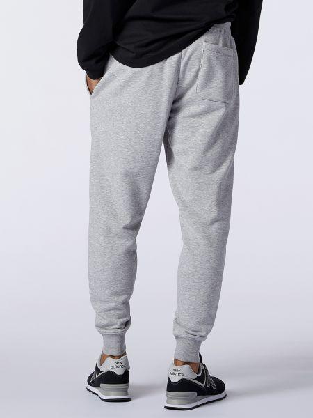 Серые спортивные брюки с карманами в рубчик New Balance