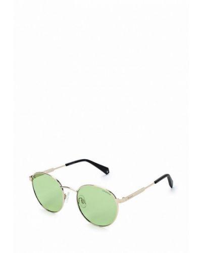 Солнцезащитные очки золотого цвета Polaroid