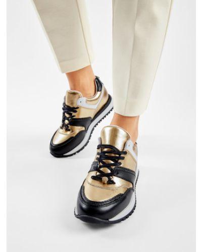 Żółte złote sneakersy Eva Longoria