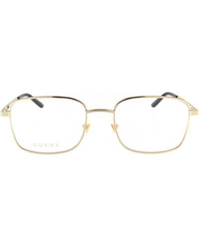 Żółte złote okulary Gucci