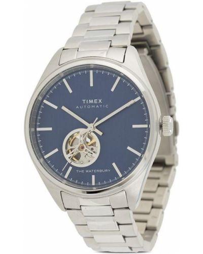 Серебряные часы круглые Timex