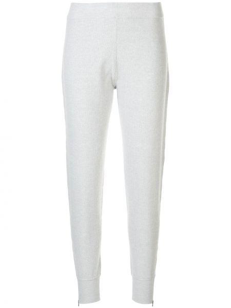 Серые спортивные брюки в рубчик с карманами с манжетами Duffy