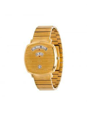 Часы золотистые Gucci