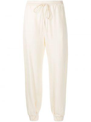 Желтые трикотажные брюки с поясом Manning Cartell