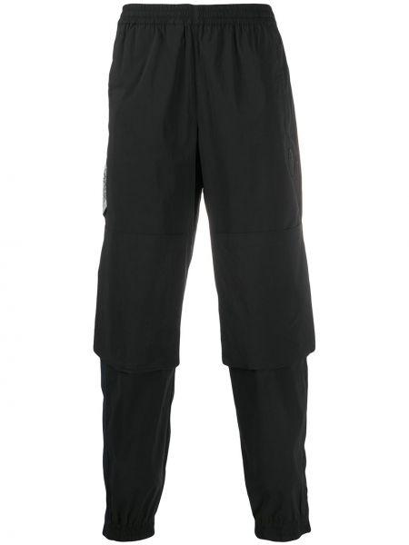 Sportowe spodnie z kieszeniami czarne Perks And Mini