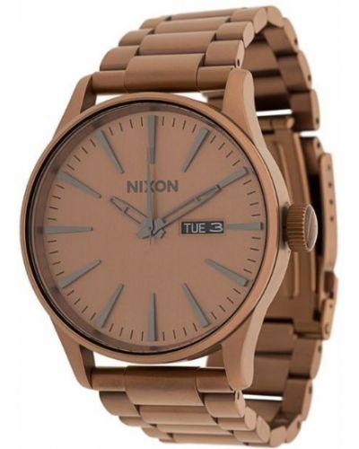 Часы коричневый Nixon