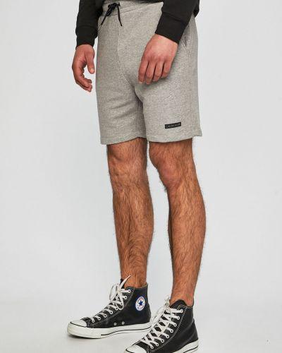 Джинсы джоггеры с карманами Calvin Klein Jeans