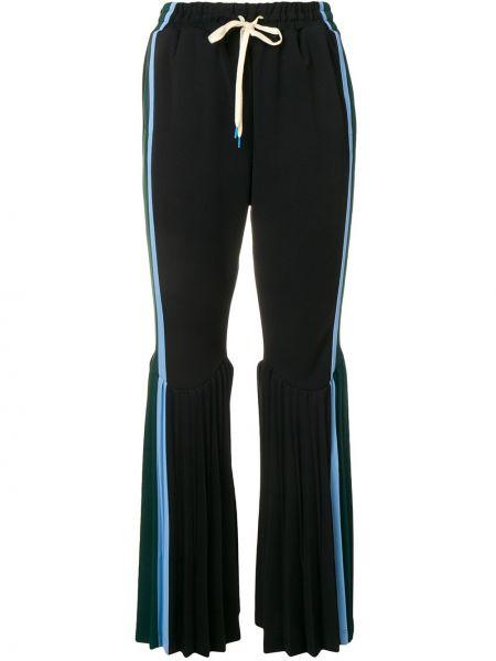 Czarne spodnie rozkloszowane Facetasm