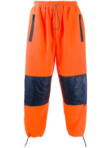 Pomarańczowe spodnie Lc23
