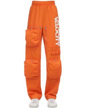 Pomarańczowe spodnie bawełniane z falbanami Calvin Klein Established 1978