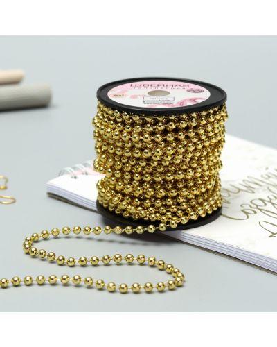 Ожерелье с жемчугом золотое круглое арт узор