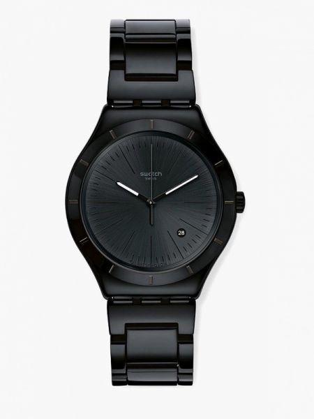 Черные часы швейцарские Swatch