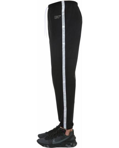 Czarne spodnie bawełniane z haftem Ufu - Used Future