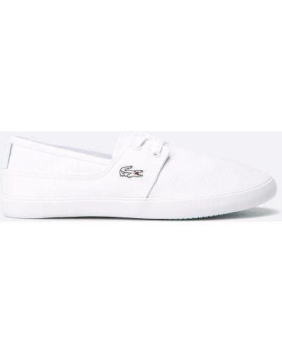 Низкие кеды белые на шнуровке Lacoste