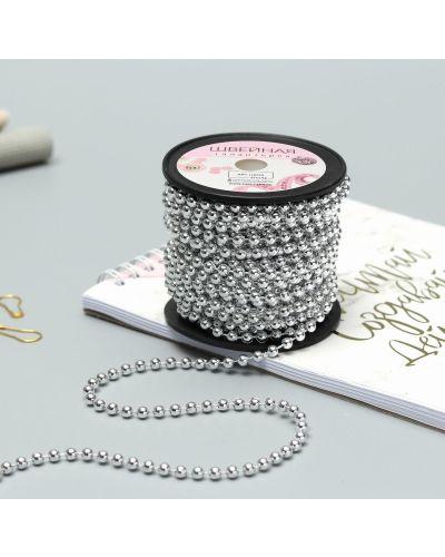 Серебряное ожерелье с жемчугом круглое арт узор