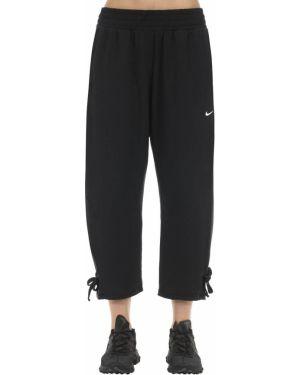 Spodnie na gumce przycięte na jogę Nike