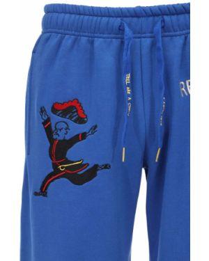 Niebieskie joggery z haftem bawełniane Kidsuper Studios