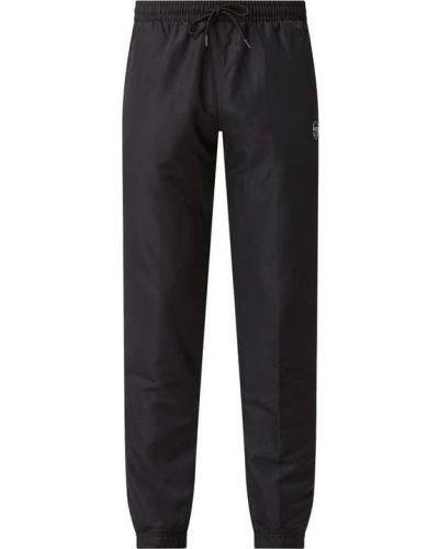 Czarne spodnie z printem Sergio Tacchini