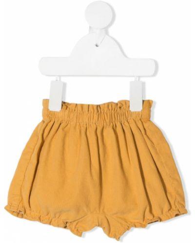 Желтые расклешенные шорты с оборками эластичные Knot
