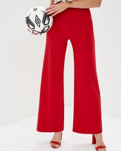 Красные брюки расклешенные Naanaa