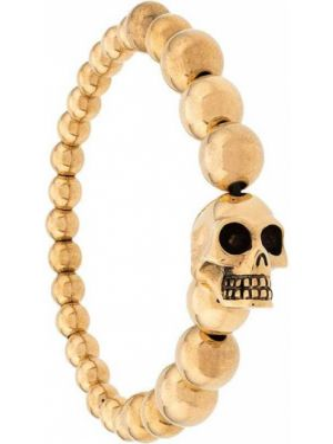 Золотистый браслет с черепами золотой Alexander Mcqueen