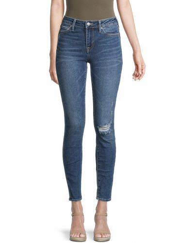 Джинсовые синие зауженные джинсы с заплатками True Religion