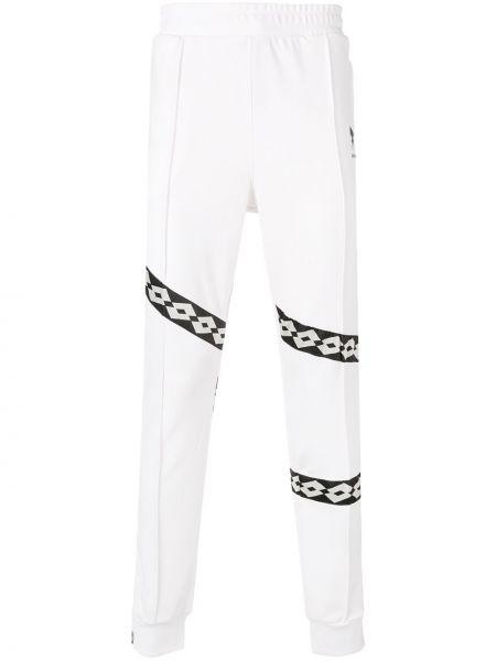 Białe joggery w paski z haftem Damir Doma