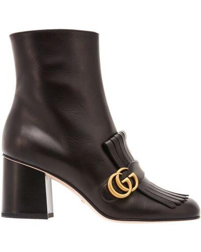 Кожаные сапоги с бахромой на каблуке Gucci