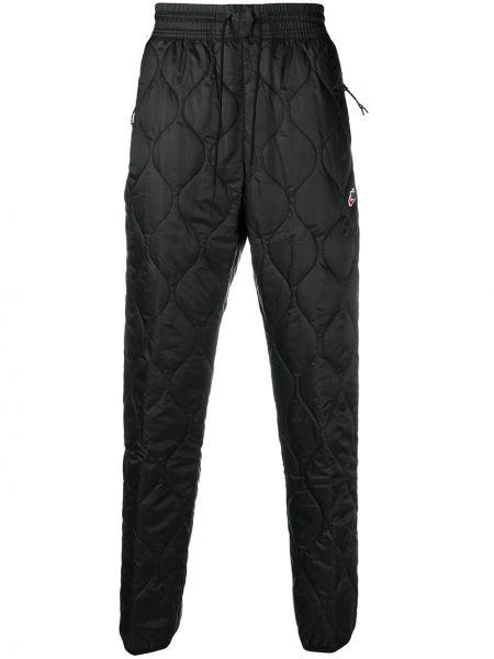 Ze sznurkiem do ściągania spodni czarny spodnie z kieszeniami Nike