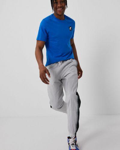 Szare spodnie materiałowe Nike Sportswear