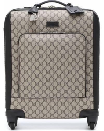 Коричневый чемодан Gucci