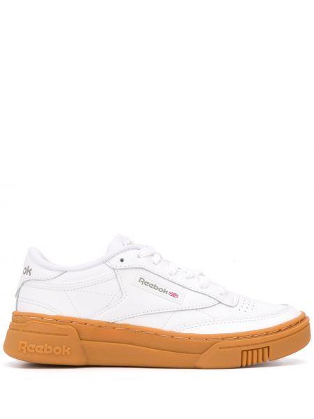 Кожаные белые кроссовки на шнурках Reebok