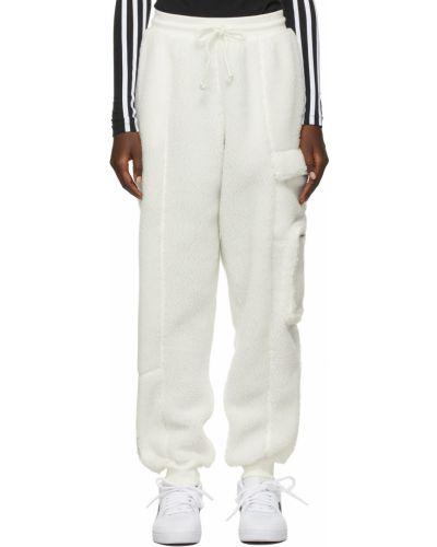 Białe spodnie z haftem Adidas X Ivy Park
