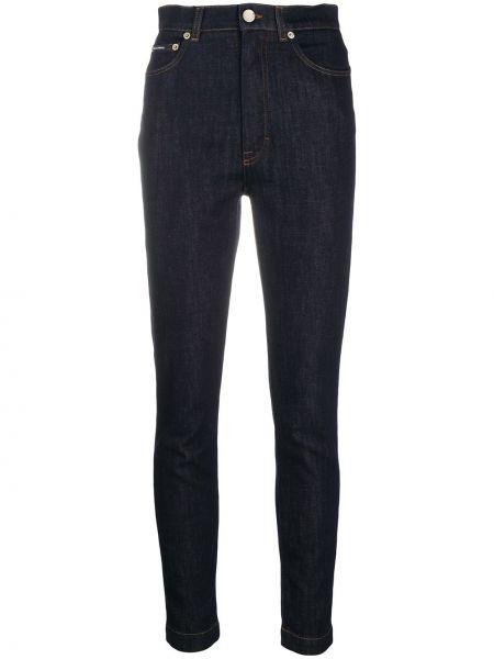Bawełna zawężony jeansy na wysokości z kieszeniami z łatami Dolce And Gabbana