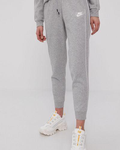 Szare spodnie bawełniane Nike Sportswear