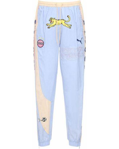 Niebieskie spodnie z printem Puma Select