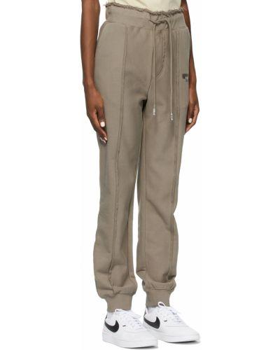 Białe spodnie srebrne Ader Error